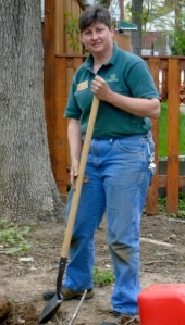Bonnie Petry shown as usual  seen with a shovel or watering can in her hands.